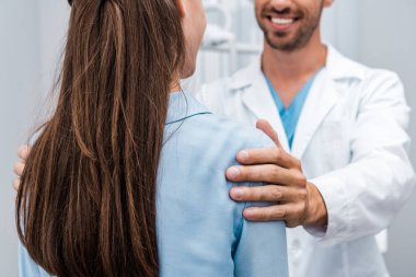 selective focus of woman standing near bearded man in clinic