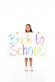 cheerful african american schoolgirl holding placard with back to school inscription on white background