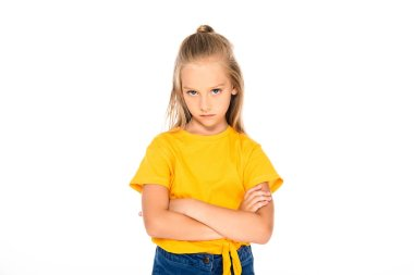 Displeased child looking at camera while standing with crossed arms isolated on white stock vector