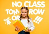 happy schoolchild holding tasty apple and books near no class tomorrow lettering on orange