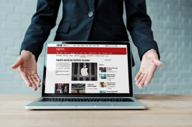 KYIV, UKRAINE - AUGUST 5, 2019: cropped view of woman gesturing near laptop with bbc website on screen stock vector