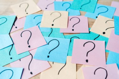 selective focus of question marks on colorful sticky notes