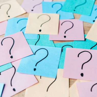 Close up of question marks on colorful sticky notes stock vector