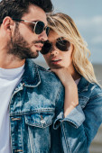 Photo attractive woman and handsome man in denim jackets hugging outside