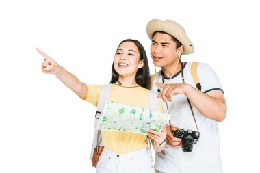 Two cheerful asian tourists pointing with fingers while holding map isolated on white stock vector