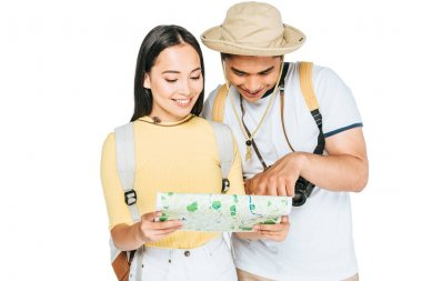 Two young asian tourists smiling while looking at map isolated on white stock vector