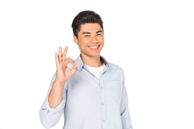Happy asian man showing okay sign while smiling at camera isolated on white stock vector