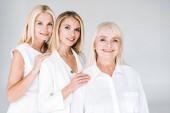 Fotografie tři generace usmívající se blondýny osamocé šedé