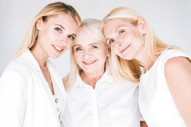 three generation blonde beautiful women isolated on grey