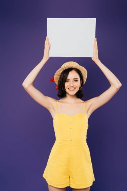 Happy girl in straw hat holding empty board above head isolated on purple stock vector
