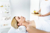 selective focus of woman with closed eyes lying on massage mat