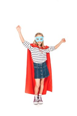Full length view of kid in mask and hero cloak dancing isolated on white stock vector