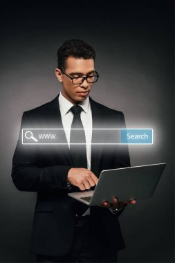 African american businessman using laptop on dark background with search bar illustration stock vector