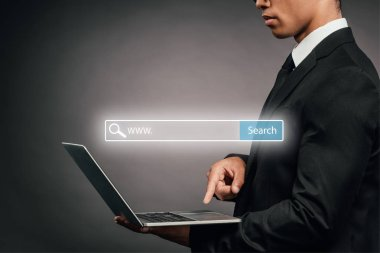 Partial view of african american businessman using laptop on dark background with search bar illustration stock vector