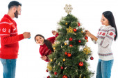 happy family decorating christmas tree isolated on white