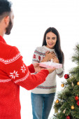 Fotografie cropped view of man giving present to cheerful woman and christmas tree isolated on white