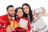 Photo happy family with presents taking selfie isolated on white