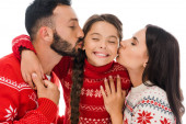 Photo happy parents kissing cheeks of daughter in sweater isolated on white