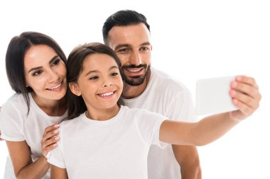 selective focus of cheerful family taking selfie isolated on white