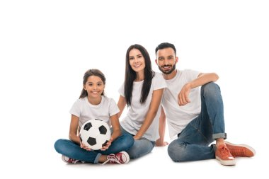 happy family sitting with football isolated on white