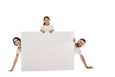 Cheerful parents and happy daughter near blank placard isolated on white stock vector