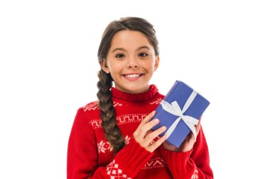Happy kid in sweater holding present isolated on white stock vector