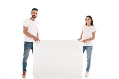 Happy bearded man and woman standing near blank placard isolated on white stock vector