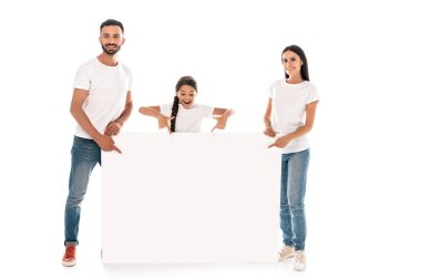 Happy parents and kid pointing with fingers at blank placard isolated on white stock vector