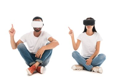 Happy man sitting with woman while using virtual reality headsets and pointing with fingers on white stock vector