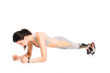 disabled sportswoman with prosthesis standing in plank isolated on white