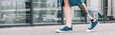 Panoramic shot of disabled woman in denim skirt walking on street stock vector