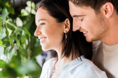 Selective focus of handsome man smiling near positive girl stock vector