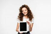 attractive smiling woman showing digital tablet with blank screen, isolated on white