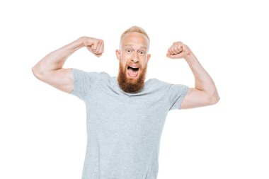 Handsome excited man in grey t-shirt win something, isolated on white stock vector