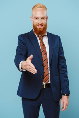 Confident smiling bearded businessman with hand for handshake, isolated on blue stock vector