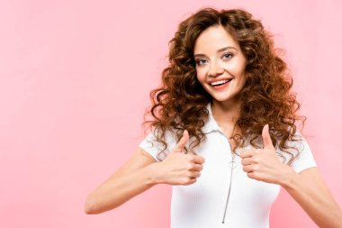 Beautiful happy girl showing thumbs up, isolated on pink stock vector