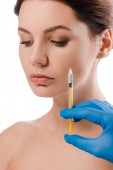 cropped view of plastic surgeon in blue latex glove holding syringe near beautiful naked patient isolated on white