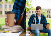 collage of handsome student using laptop and holding paper cups near books, online study concept