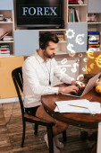 Selective focus of freelancer in shirt and panties using headset and laptop near papers on table at home, forex illustration