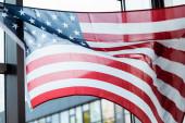 American flag near window in living room