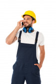 Smiling repairman in overalls talking on smartphone isolated on white