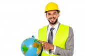 Photo Engineer in hardhat and safety vest pointing with finger at globe and smiling at camera isolated on white