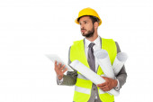 Photo Handsome engineer holding blueprints and digital tablet while looking away isolated on white