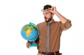 Surprised teacher holding eyeglasses and looking at globe isolated on white