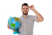 Photo Smiling nerd holding eyeglasses and globe while looking at camera isolated on white