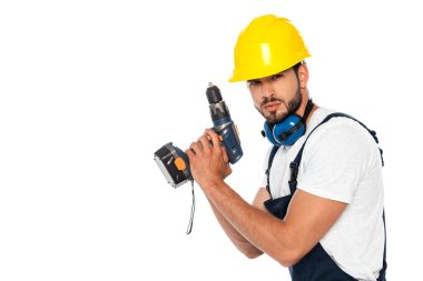 Handsome workman in hardhat and ear defenders holding electric screwdriver isolated on white stock vector