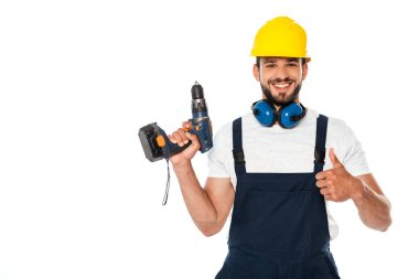 Smiling repairman showing like gesture and holding electric screwdriver isolated on white stock vector