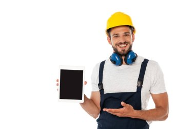 Smiling manual worker pointing with hand at digital tablet with blank screen isolated on white stock vector