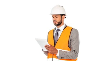 Handsome engineer in suit and safety vest using digital tablet isolated on white stock vector