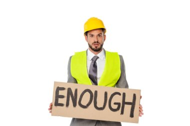 Engineer in suit and hardhat holding signboard with enough lettering isolated on white stock vector